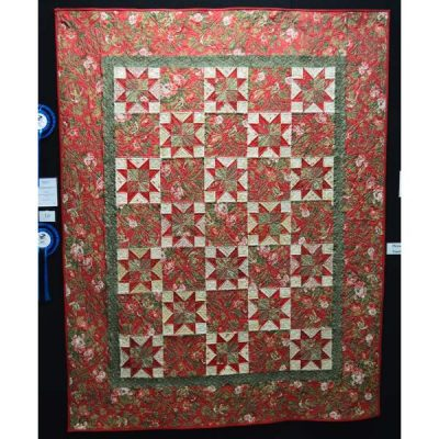 Christmas stars by Kay Nichols. Best machine quilting on long arm machine